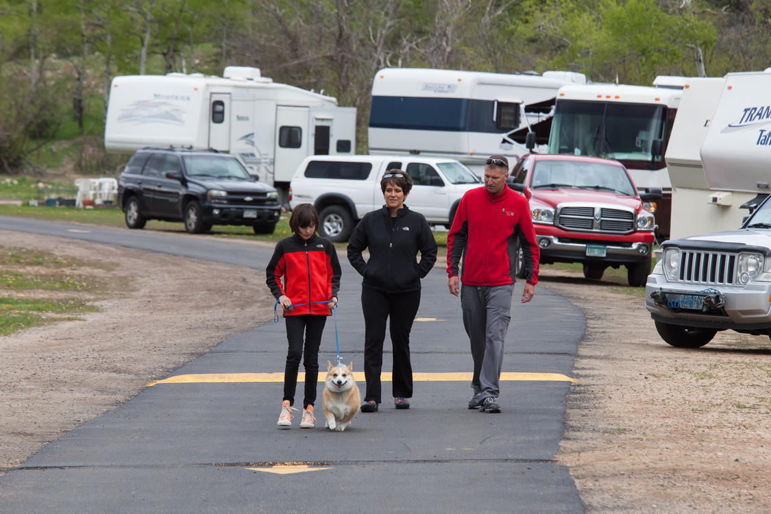 Couple Walking a Dog at Manor RV Park