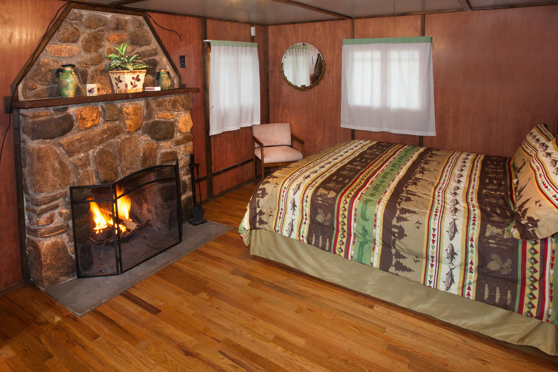 Bedroom with Fireplace at Tiny Town Cabins