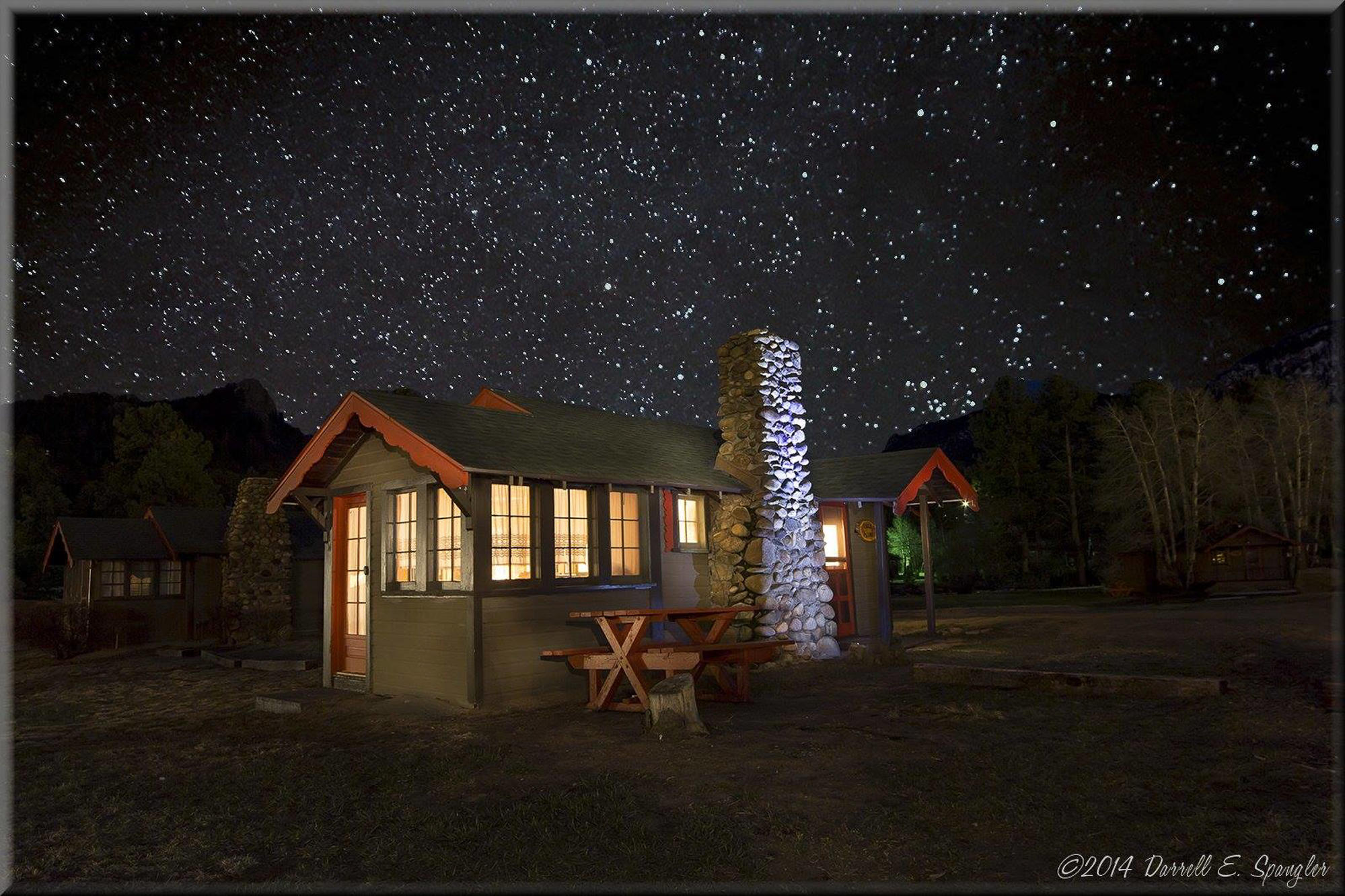Tiny Town Cabins Outside at Night
